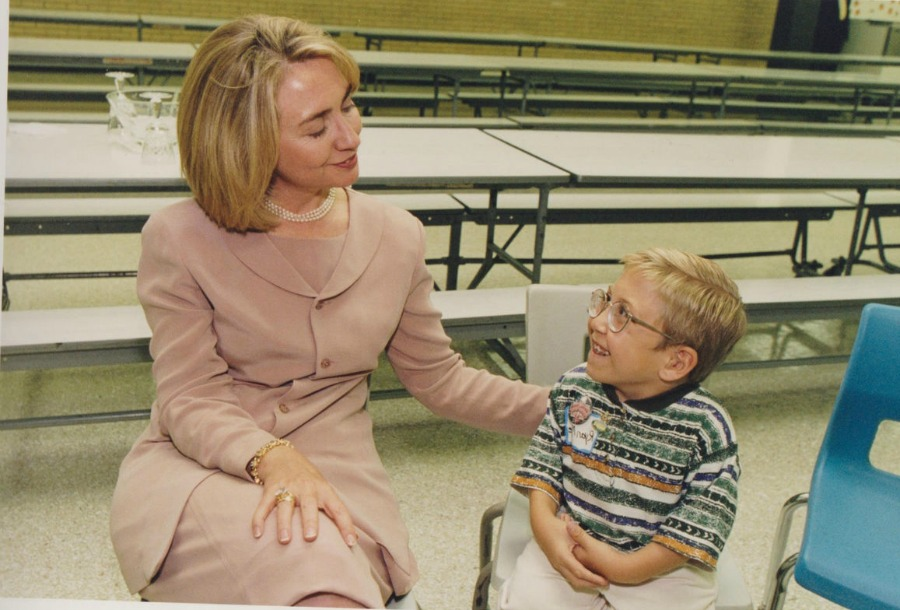 International Women's Day - Hillary Clinton with child